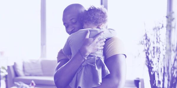 Dad cuddling baby son
