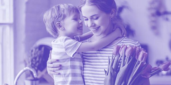 mum holding her daughter