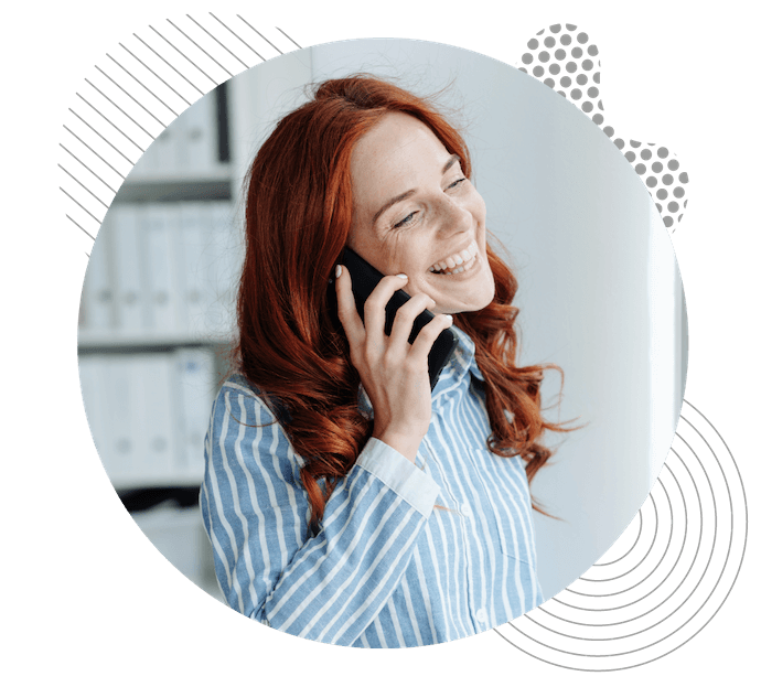 Lady with red hair on the phone in a working from home enviroment.