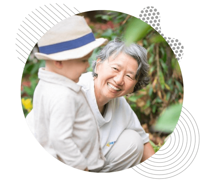 Asian lady gardening with grandson